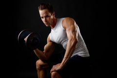 Male dumbbelll lifting Stock Images