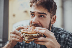 Male Eating Burger Royalty Free Stock Image
