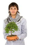 Male ecologist holding a tree Royalty Free Stock Images