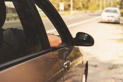 Male elbow in the window in the car, retro toning Royalty Free Stock Photography