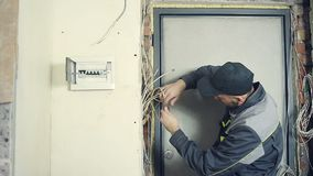 Male electrician performs installation work stock video