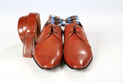 Male elegant brown shoes with belt and bow tie.  Stock Photography