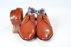 Male elegant brown shoes with belt and bow tie.  Stock Image