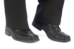 Male elegant shoes and trousers. Isolated on white background Stock Photography
