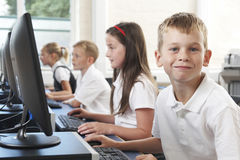 Male Elementary Pupil In Computer Class Stock Images