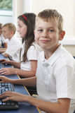 Male Elementary Pupil In Computer Class Royalty Free Stock Photo