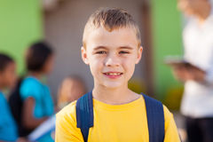 Male elementary pupil. Cute male elementary pupil outside classroom Stock Photo