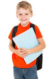 Male elementary pupil. Happy male elementary pupil holding books Stock Photos