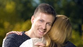 Male embracing female and looking at camera, love relationship, marriage agency stock photos