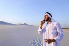 Male Emirati designer completes site survey for construction sit Stock Image