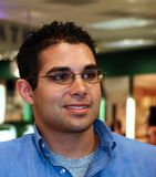Male Employee with Glasses. Male retail store employee wearing glasses photographed in retail store Stock Images
