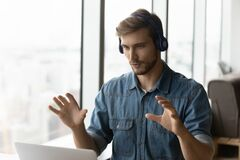 Free Male Employee In Earphones Have Webcam Zoom Call Stock Photography - 217134452