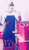 Male employee packing wine bottles at sparkling wine factory royalty free stock images