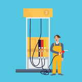 Male employee standing in gas station holding fuel nozzle petrol occupation working job as attendant Stock Photos