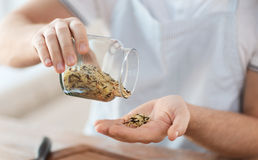 Male emptying jar with white and wild black rice Stock Image