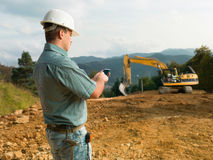 Male engineer on construction site Royalty Free Stock Image