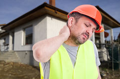 Male engineer or constructor with neck pain stock photo