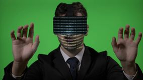 Male engineer dressed in suit and tie using virtual reality technology to type and check blockchain data on green screen -. Male engineer dressed in suit and tie stock video footage
