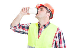 Male engineer drinking hot coffee. In his lunch break isolated on white background Stock Image