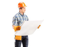 Male engineer with helmet and tool belt holding a blueprint Royalty Free Stock Image
