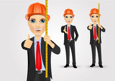 Male engineer with holding tape measure Royalty Free Stock Photo