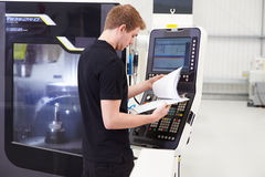 Male Engineer Operating CNC Machinery On Factory Floor Royalty Free Stock Images