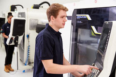 Male Engineer Operating CNC Machinery On Factory Floor Royalty Free Stock Photo