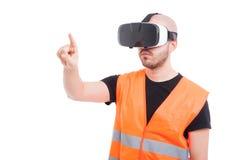 Male engineer pressing on virtual screen Stock Image