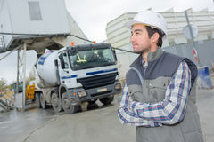 Male engineer standing in front truck on building site. Male engineer standing in front of truck on building site Stock Photos