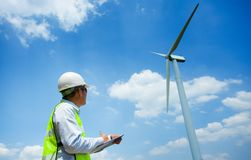 Male Engineer or tecnician at Work wind turbine generator station,. Wind enegy,wind power concept Stock Image