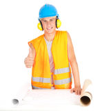Male engineer with thumb up looking at blueprints Stock Images