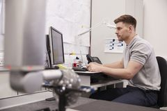 Male Engineer Uses CMM Coordinate Measuring Machine In Factory royalty free stock photo