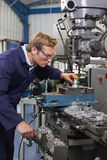 Male Engineer Using Drill In Factory Royalty Free Stock Photography
