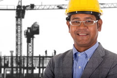 Male engineer wear yellow helmet with construction crane Royalty Free Stock Photo