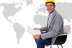 Male engineer wear yellow helmet with world map. Male engineer wear a yellow helmet with world map Stock Image