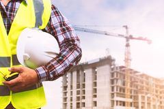 Engineer is working at a construction site. A male engineer is working at a construction site Royalty Free Stock Photography