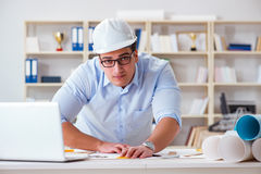 The male engineer working on drawings and blueprints Stock Image