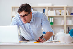 The male engineer working on drawings and blueprints Stock Photography