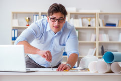The male engineer working on drawings and blueprints Royalty Free Stock Images