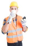 Male engineer in workwear drinking his morning coffee Royalty Free Stock Photos
