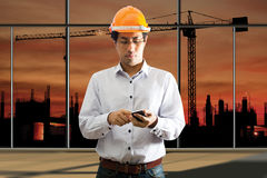 Male engineering using smart phone Royalty Free Stock Images
