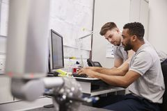 Male Engineers Use CMM Coordinate Measuring Machine In Factory royalty free stock image