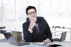 Male entrepreneur daydreaming on table Stock Image