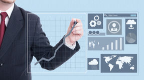 Male entrepreneur drawing with marker on screen Royalty Free Stock Photo
