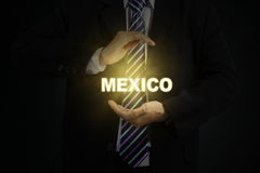 Male entrepreneur protecting word of Mexico Royalty Free Stock Photography