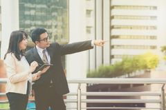A male entrepreneur is recommending a job with his female secret. Ary Royalty Free Stock Image