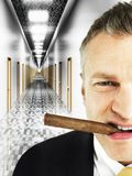 Male Entrepreneur Smoking In Corridor Stock Photos