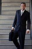 Male Entrepreneur Walking Down Stairs. Portrait of smart male entrepreneur walking down the stairs Stock Photos
