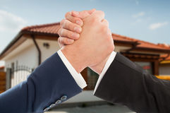 Male estate brokers shaking hands. In a friendly way in close-up view Royalty Free Stock Images