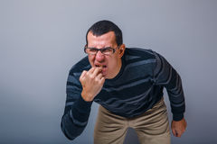 Male of European appearance brunet put his fingers Stock Photo